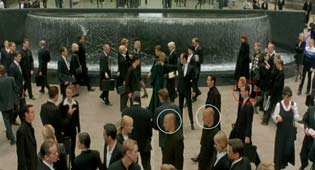 Neo is confronted by an agent in the Matrix's simulation and one can see that the scene was shot in Martin Place, Sydney.